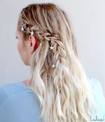 white woman with long wavy hair styled with sparkle