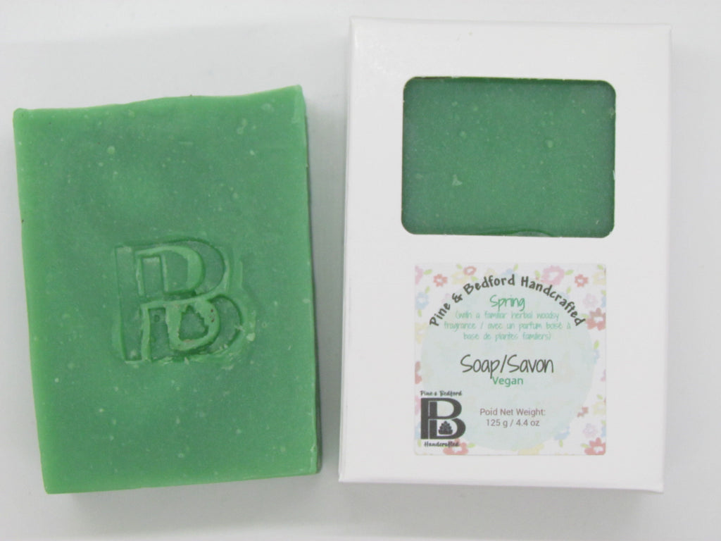 Pine and Bedford's Spring soap. A green, tall and thin soap bar with a familiar woody herbal fragrance. Shown here naked and boxed.