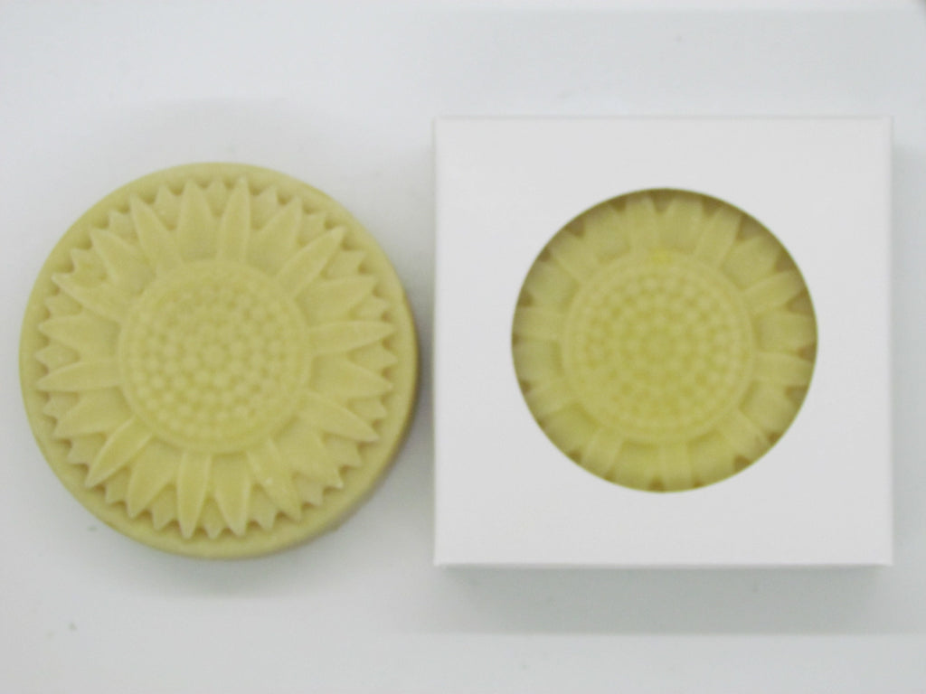 Pine and Bedford's Soleil Guest Soap.  A yellow soap in the shape of a sunflower with a soft sunny fragrance.  Shown here naked and also boxed.