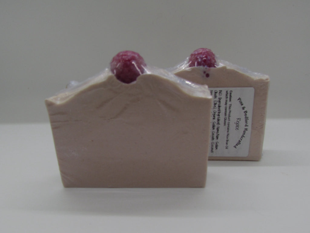 Pine and Bedford's Rejoice Soap. A light pink with a red soap raspberry on the top of its centre peak.
