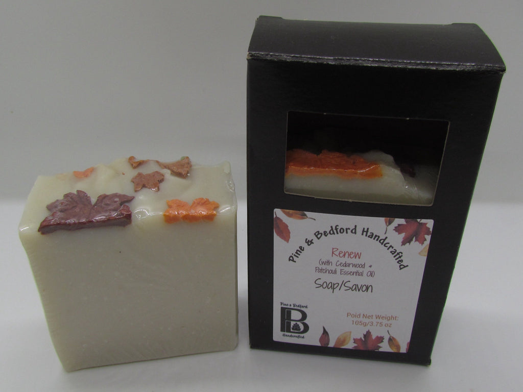 P&B's Renew soap is a maple sugar coloured soap with soapy maple leaves of orange, brown and bronze on top. Shown here naked and boxed.