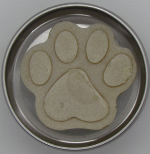 Pine and Bedford's Minty Fresh Dog Soap. A paw-shaped light brown dog soap in an open tin.
