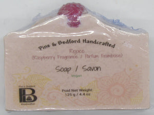 Pine and Bedford's Rejoice Soap. A raspberry fragranced soap in pink with a red raspberry embellishment on top.