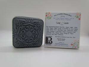 Pine and Bedford's Groovy square with top motif soap shown naked and boxed.