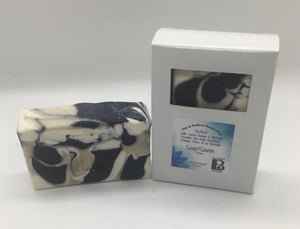 Pine and Bedford's Reflect Soap Bar. A cream, navy and khaki swirled soap with an Orange Patchouli fragrance. Shown here naked and also boxed.