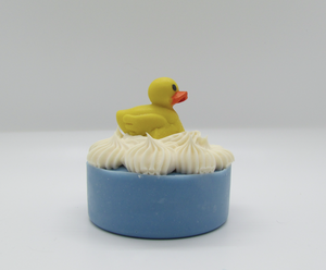 Pine and Bedford's Rubber Duckie 100% cold process soap with a Fruit Explosion fragrance.  Lots of fun at bath time. Shown naked.