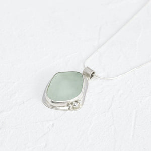 """Rosie"" sea glass pendant with heart-shaped cut-out setting"