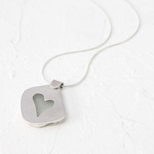 "Load image into Gallery viewer, ""Rosie"" sea glass pendant with heart-shaped cut-out setting"