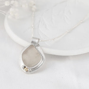 """Seychelle"" sea glass pendant with floral cut-out setting"