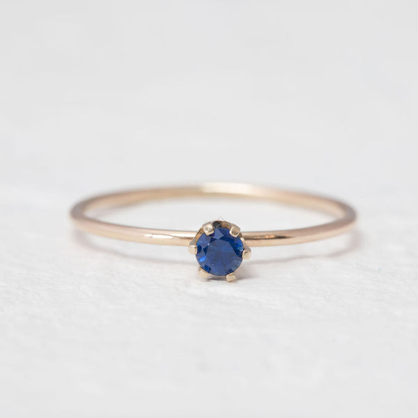 """Aster"" Delicate gold ring in London Blue Topaz"