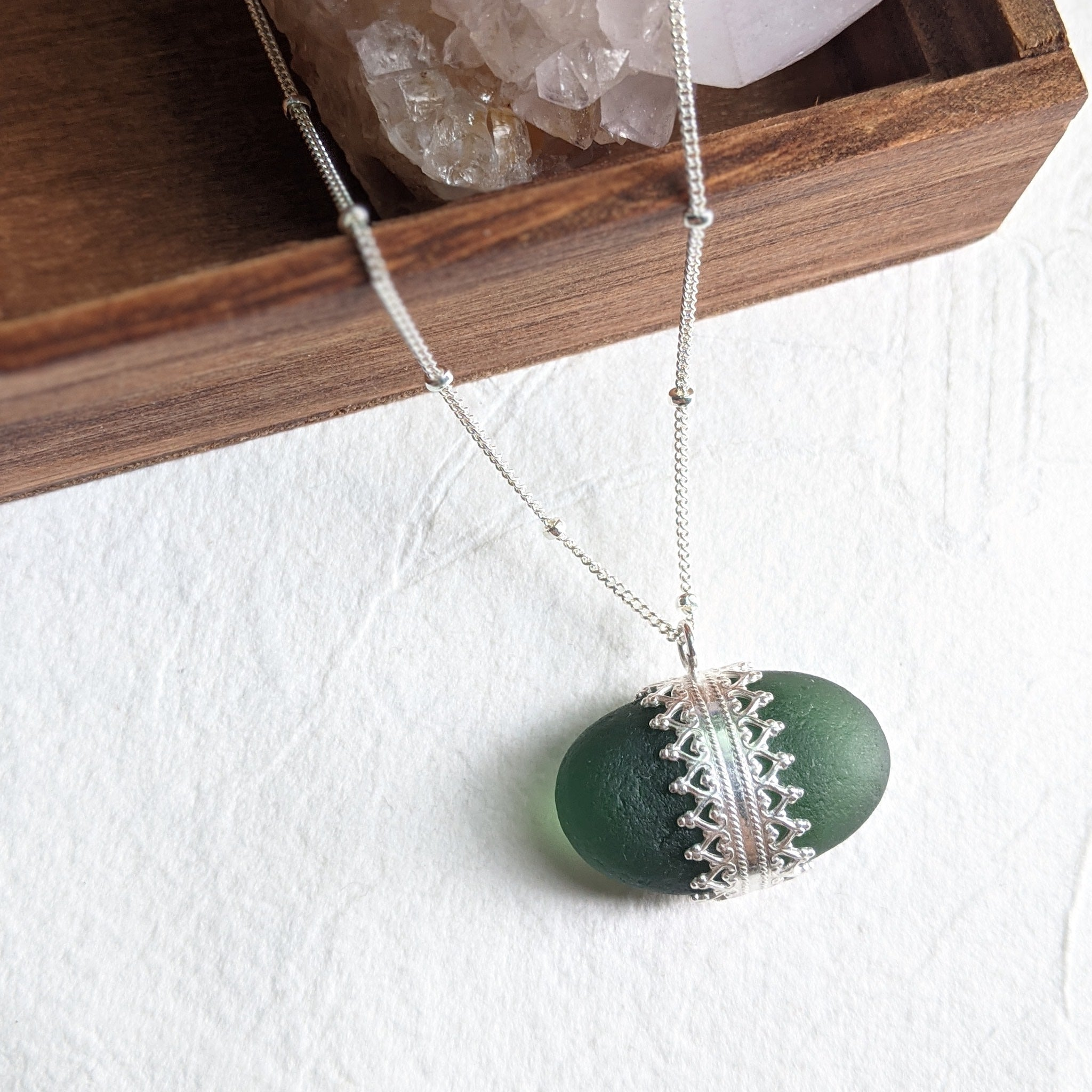 """Gwen"" Sea glass pendant with lace-patterned setting"