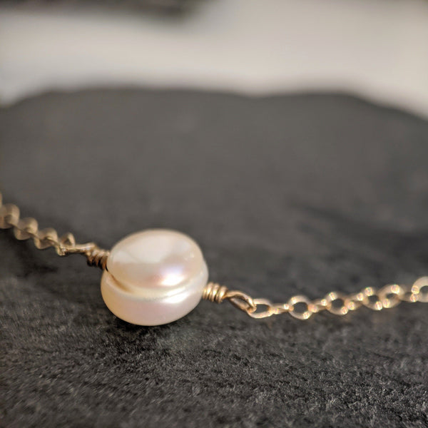 dainty pearl bracelet close up
