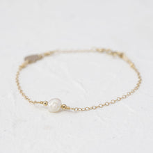 "Load image into Gallery viewer, ""Farah"" single pearl bracelet with heart charm"