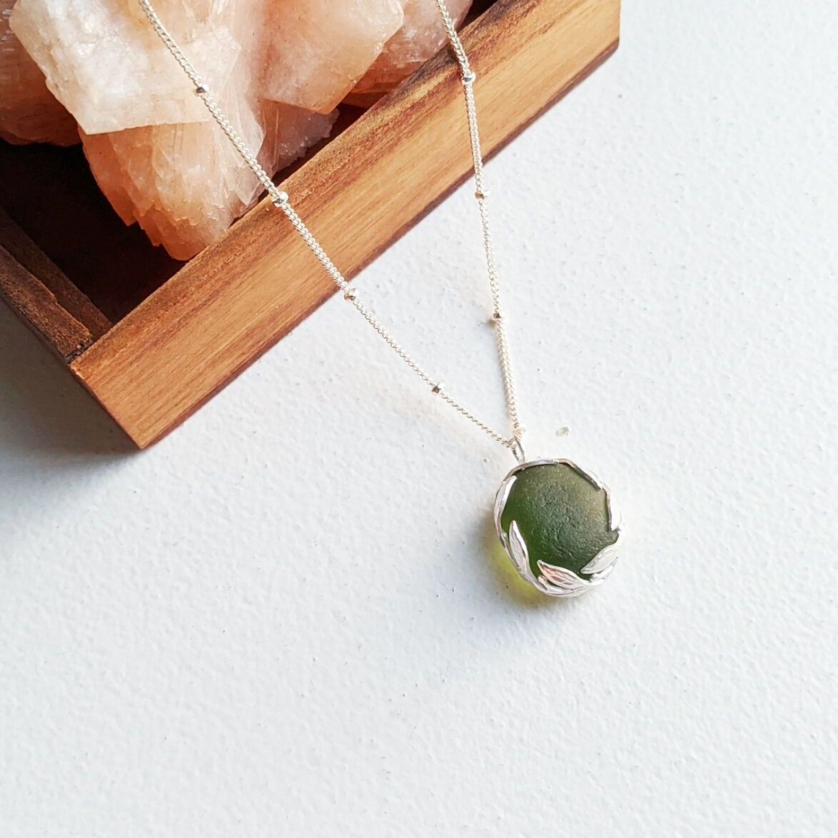 """Gwen"" Sea glass pendant with leaf-patterned setting"