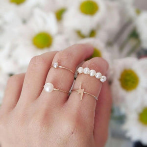 mixed and matched minimalist volume 2 rings worn by model