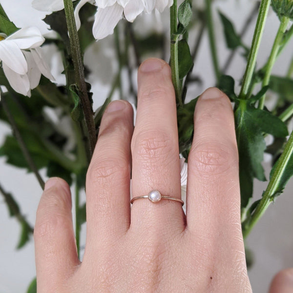 petite pearl ring worn by model