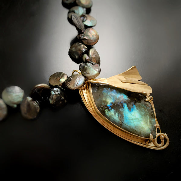 Handmade one of a kind jewelry by Erica Bapst.  This brass pendant features a signature ginkgo leaf adorning a labradorite stone.
