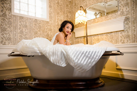 Modern Romance bridal earrings and Wrapped up in Lobe Bracelet by Erica Bapst Designs, Model: Olivia Staley. Photo: Natalie Sinisgalli Photography, Venu: Inn on Broadway, Hair: Special Occasion Hair Design, Dress: Lovely Bride Rochester, Makeup: Sunnless 2 Go