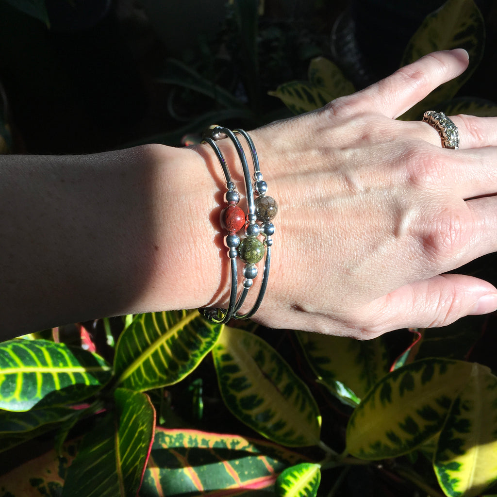 Set of three warm earth tone stone stretch stacking bracelets in silver.