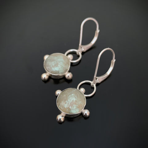 rustic sterling silver cross earrings with hand sculpted elements to look like ancient roman glass
