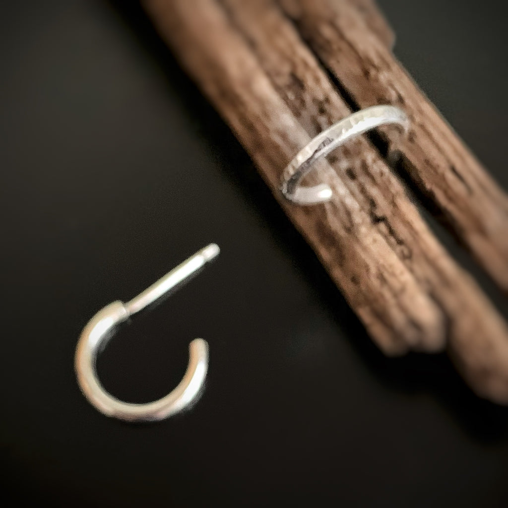 sterling silver half hoop earrings with hammered texture