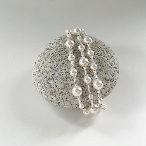three strand modern classic bridal bracelet in pearl and glittering glass.