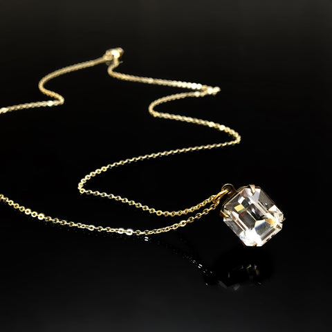 gold necklace with clear emerald cut rhinestone crystal