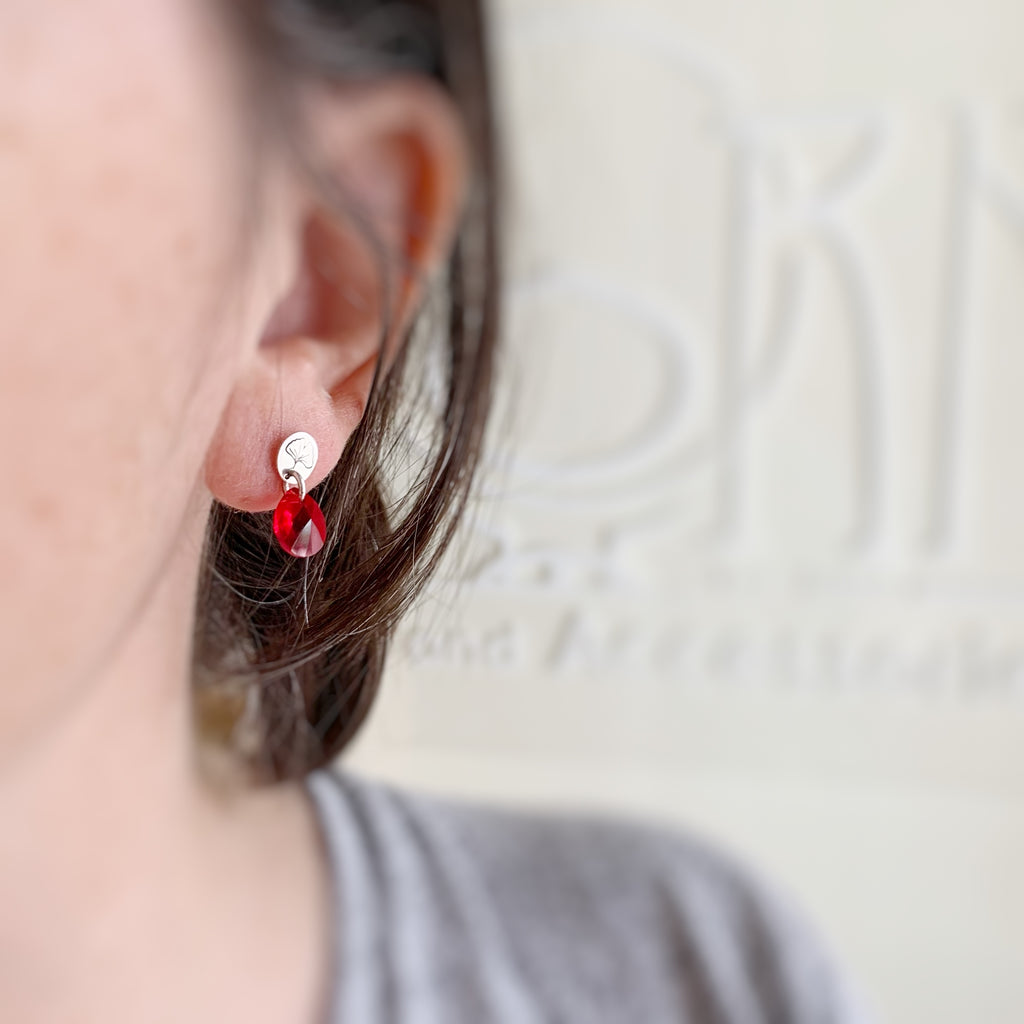 red crystal teardrop sterling silver post earrings with ginkgo leaf