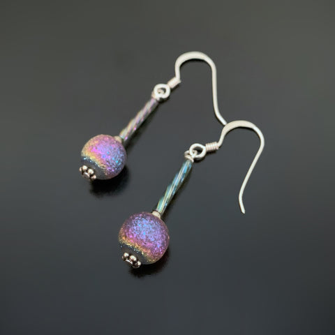 ancient looking purple iridescent glass drop earrings on sterling silver ear wires