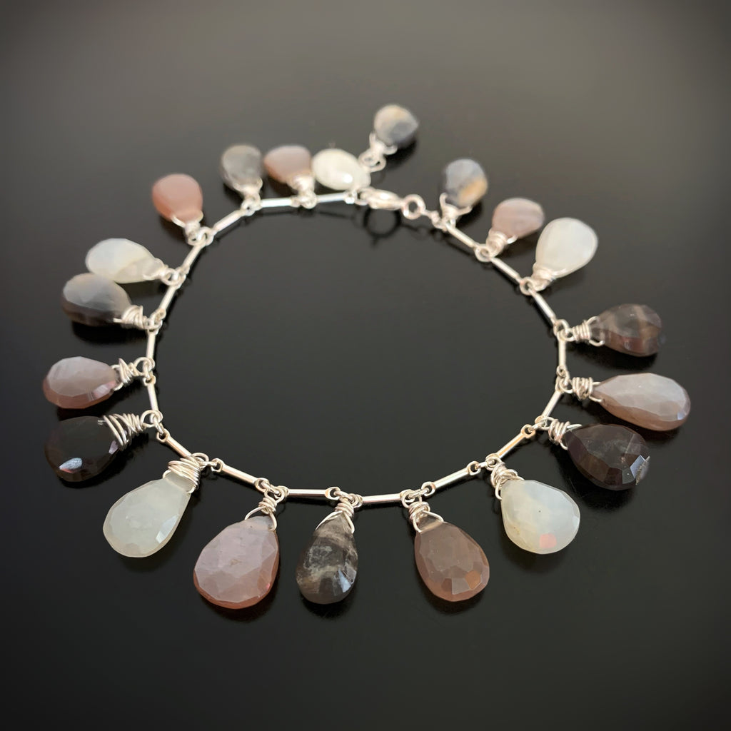 white, grey, peach and mauve moonstone teardrop charm bracelet on sterling silver chain