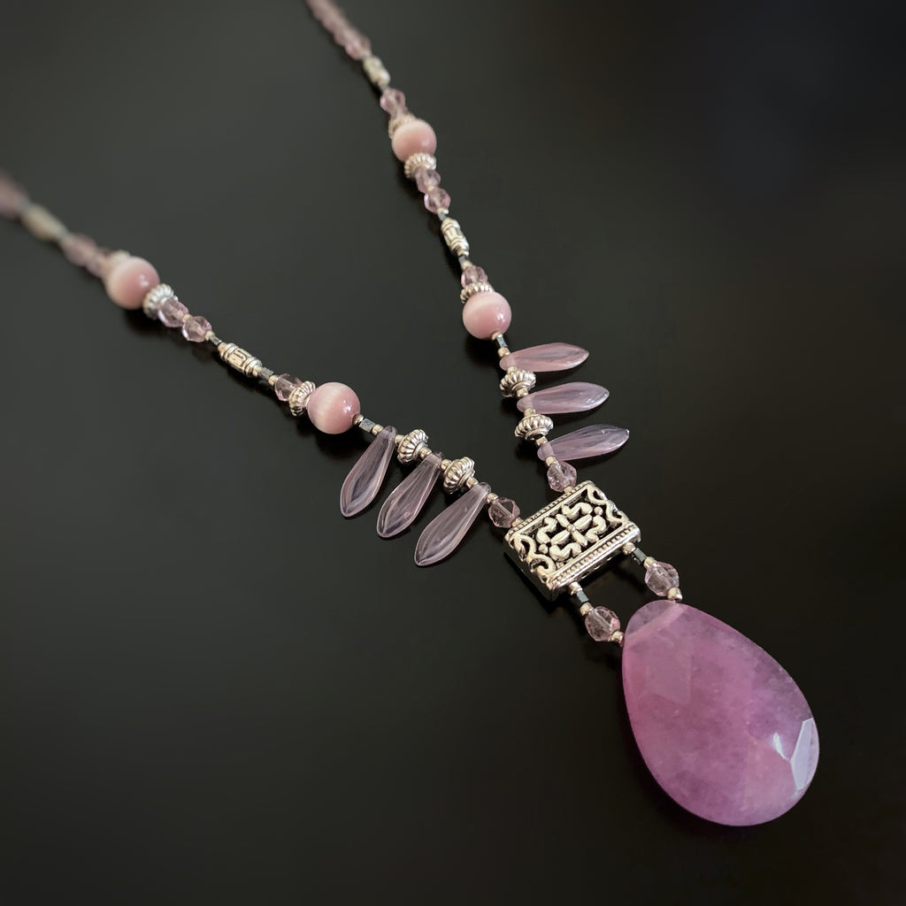purple quartz teardrop necklace with a fan of glass dagger beads and cats eye rounds