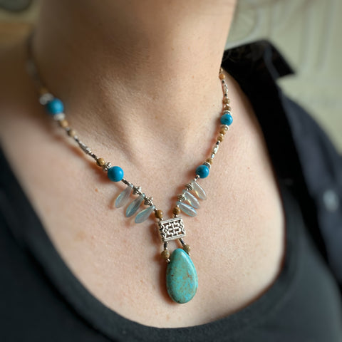 turquoise teardrop pendant necklace with fan style beads