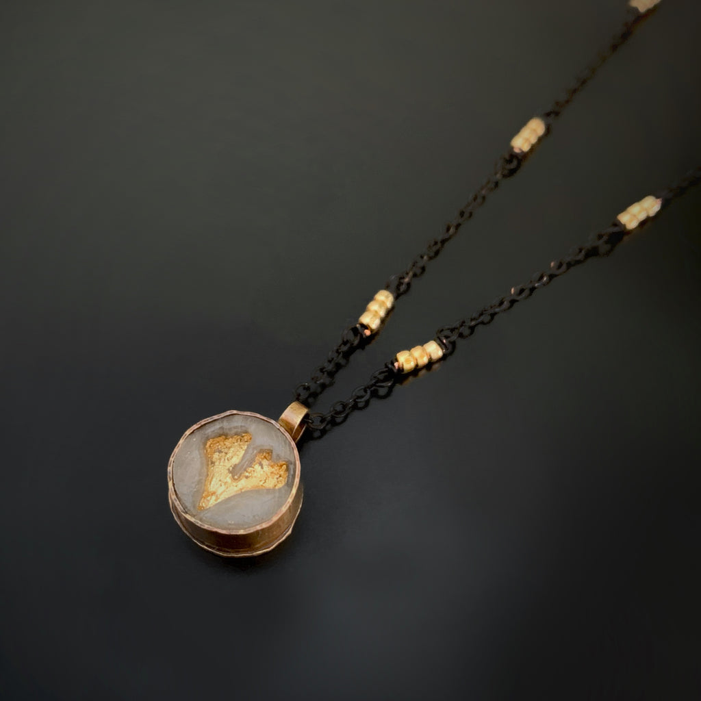 golden ginkgo leaf impression pendant necklacehandmade brass pendant with glass like cameo impression of a ginkgo leaf