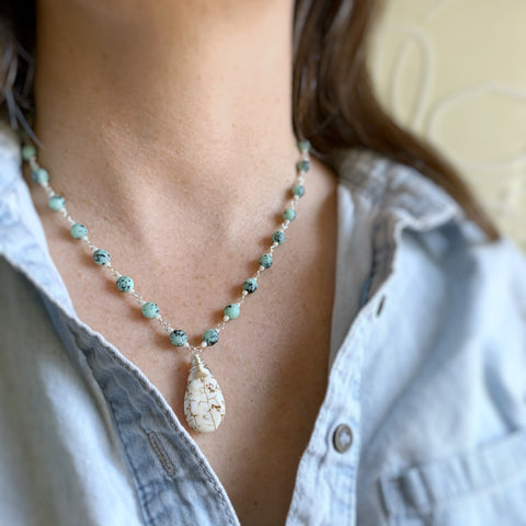 hand made link necklace with a creamy teardrop pendant and speckled turquoise glass