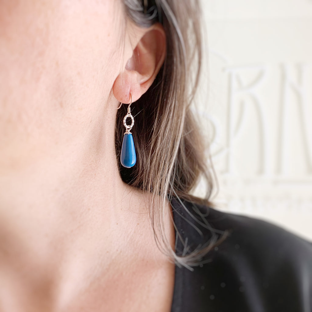 cadet blue glass teardrop earrings with sterling silver ear wires and twisted loop