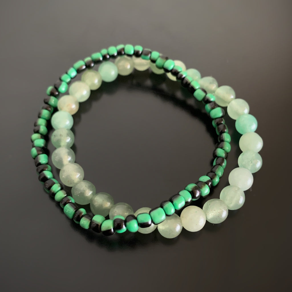 Pair of stretch bracelets, one in green aventurine, and one in green and black striped glass