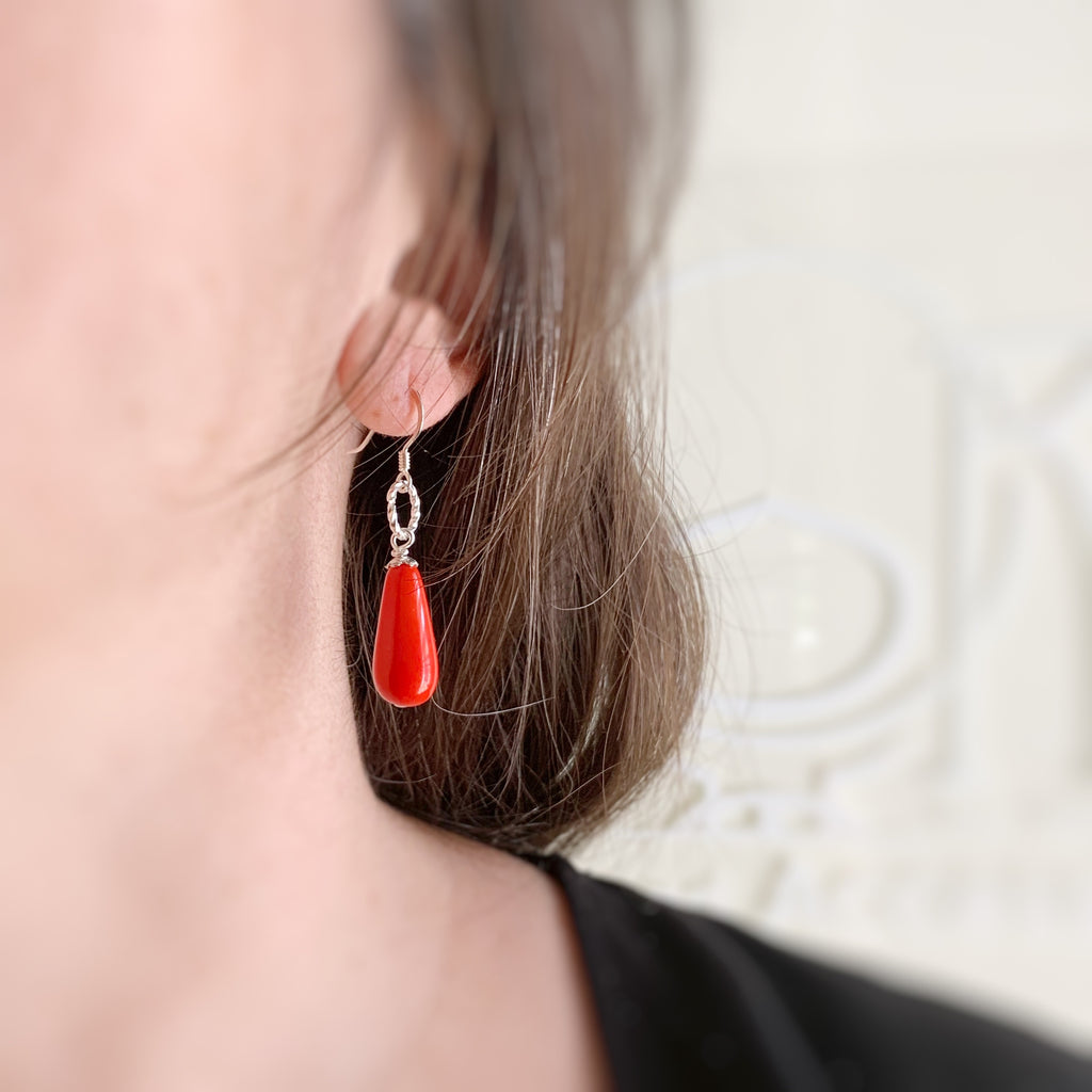 opaque red teardrop earring swith sterling silver ear wires and a twisted ring motif