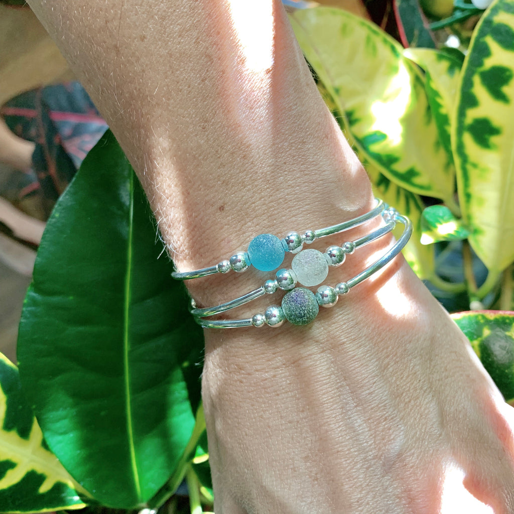 Trio of beachy glass bracelets in blues and greens