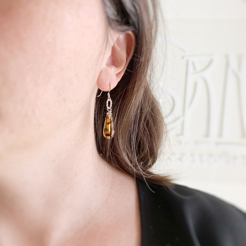 tortoise shell brown glass teardrop earrings with twisted wire circle accent and sterling silver earwires