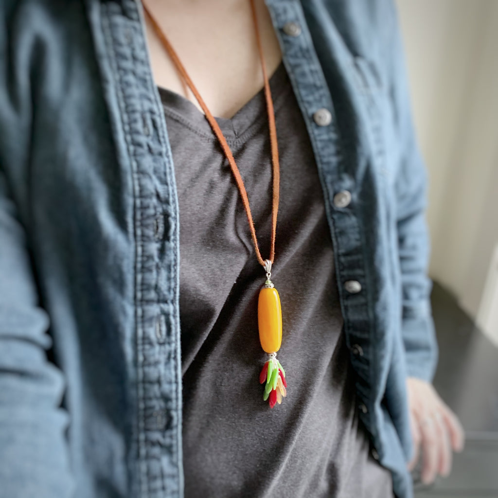 long lariat necklace in yellow, red and green