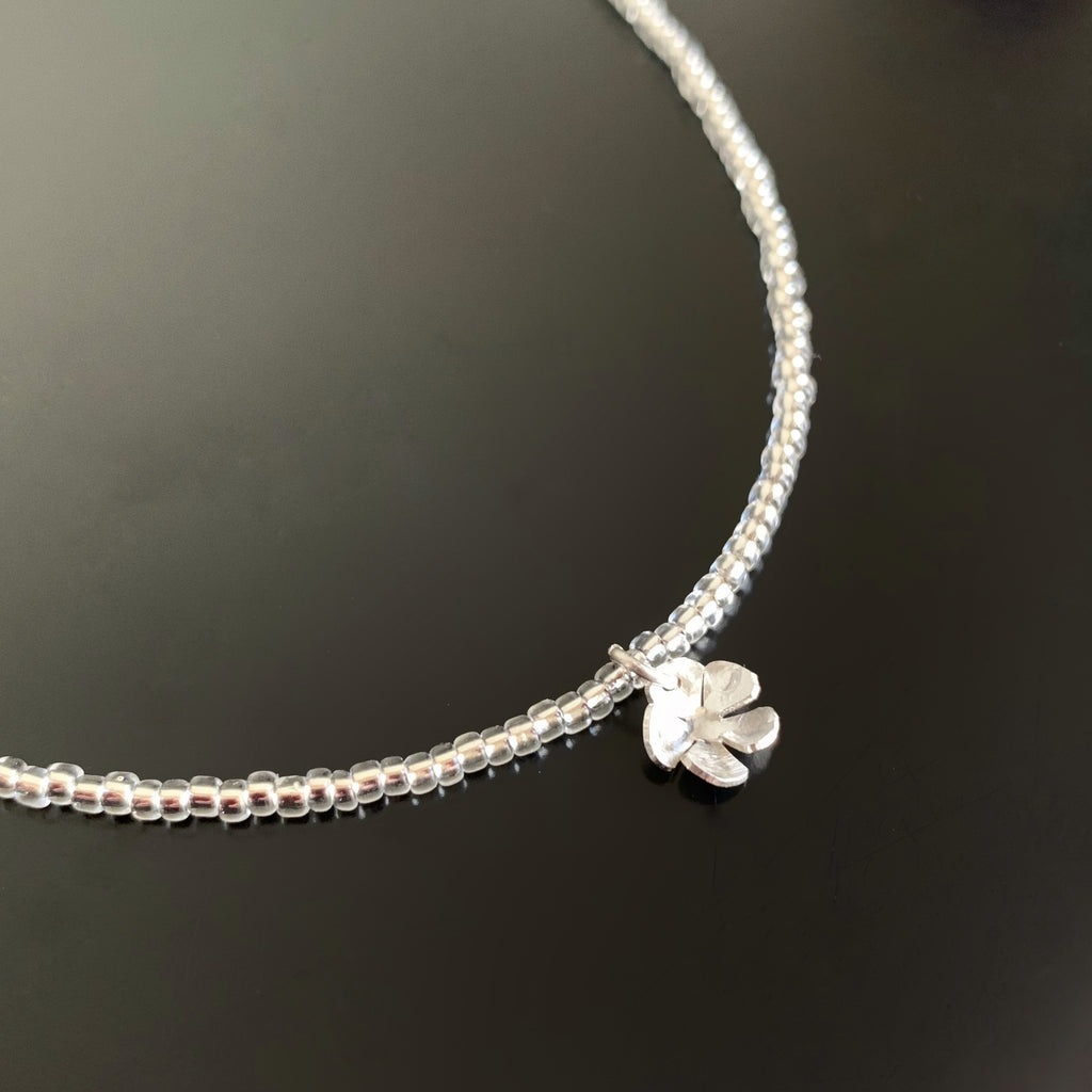 Simple Sterling Silver Flower Pendant on silver glass seed bead chain