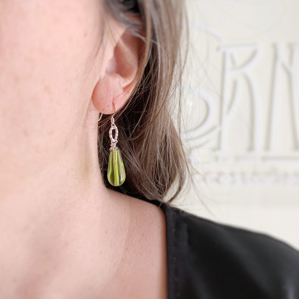 peridot green teardrop earrings with twisted ring accent