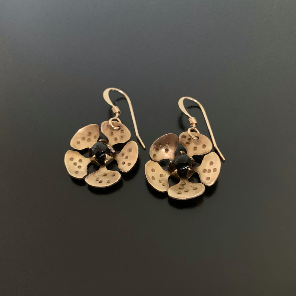 gold brass cherry blossom flower dangle earrings with black accents in the center