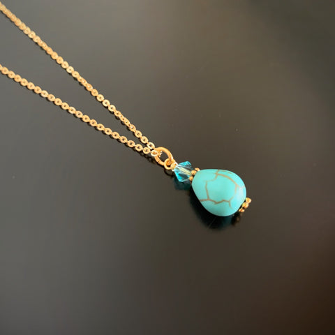 turquoise teardrop pendant with crystal accent on gold plated chain