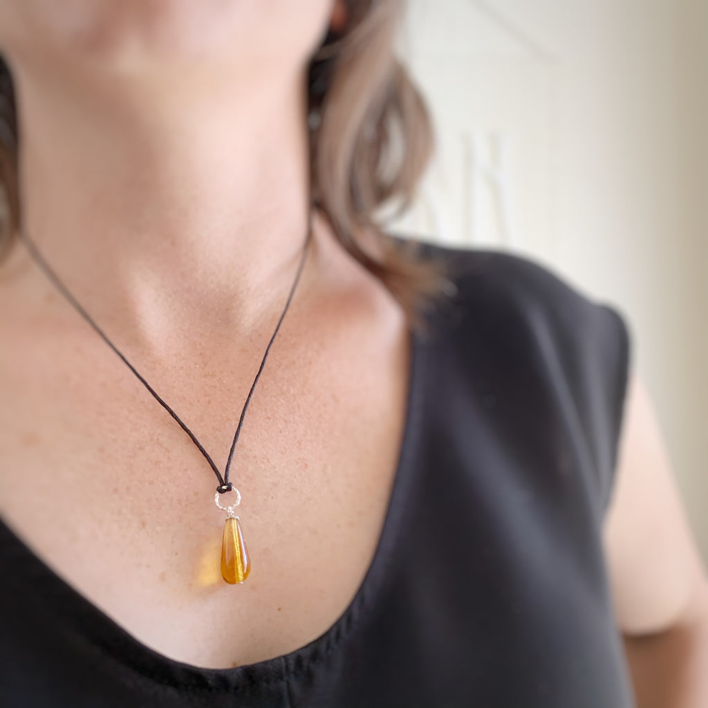 amber colored tear drop glass pendant necklace with twisted silver wire ring
