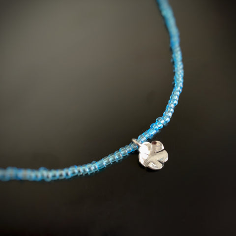 simple sterling silver pendant on an aqua blue glass seed bead chain