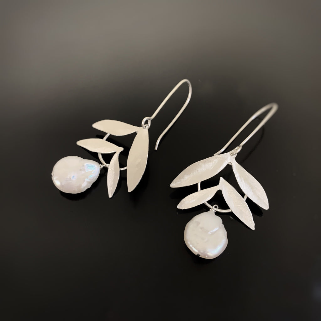 sterling silver and freahwater pearl earrings.  made in USA