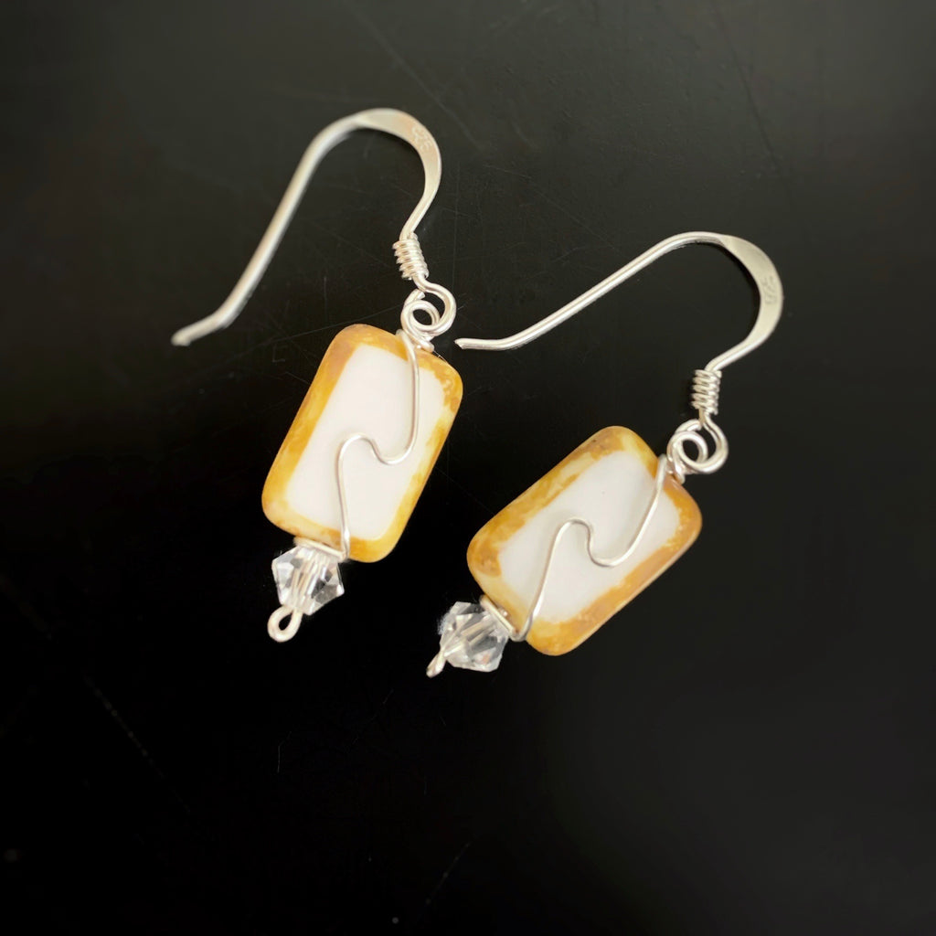 opaque white rectangle earrings with silver swirl