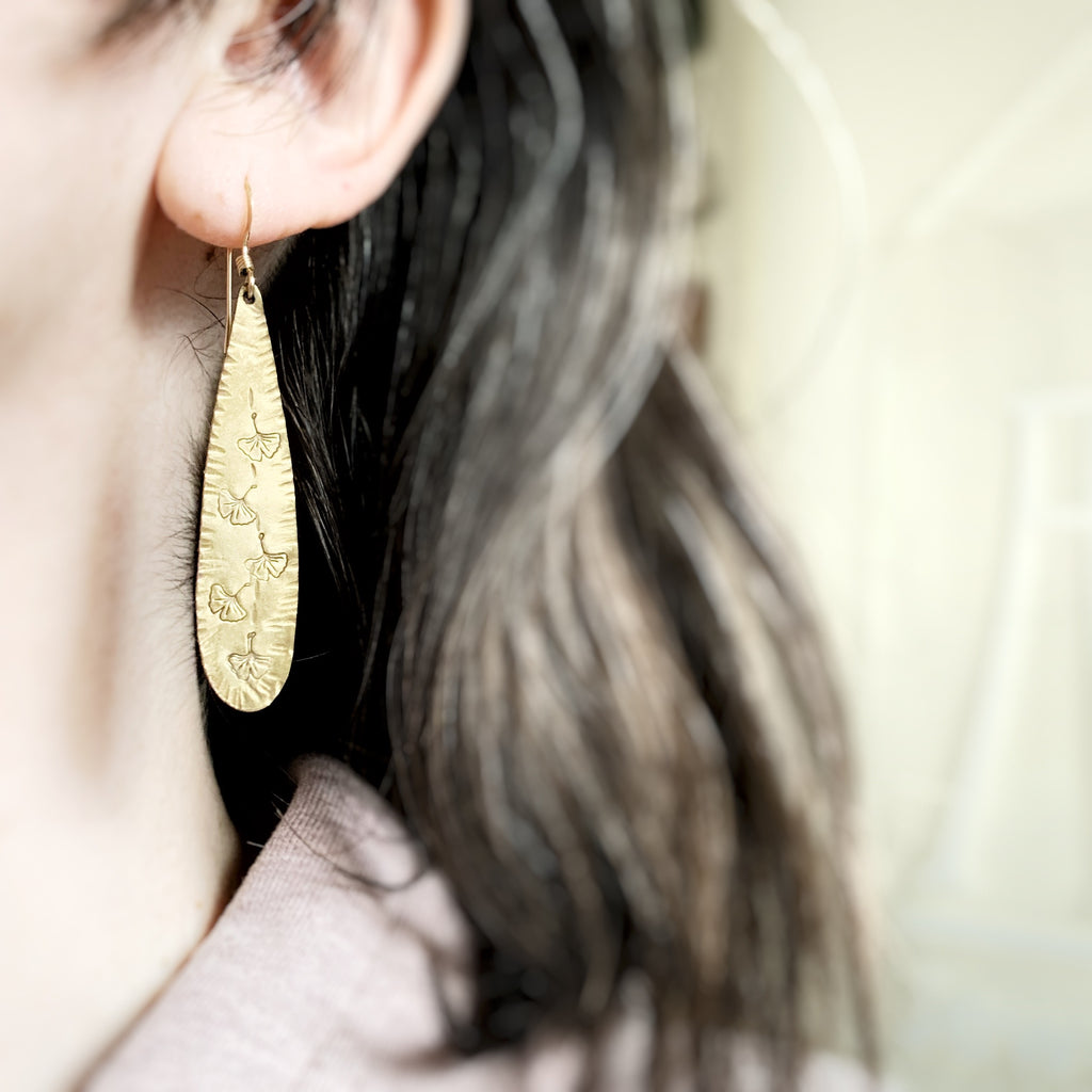 golden teardrop earrings with hammered twxture and ginkgo leaf motif
