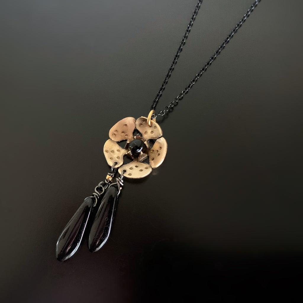 gold brass cherry blossom flower pendant with black teardrop dangle accents